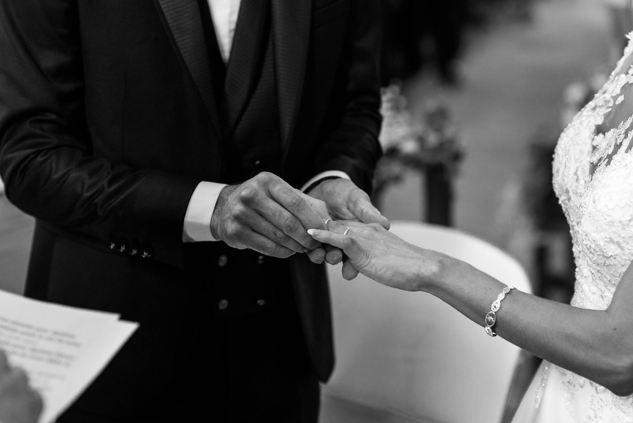 The bride and groom exchanging the wedding ring