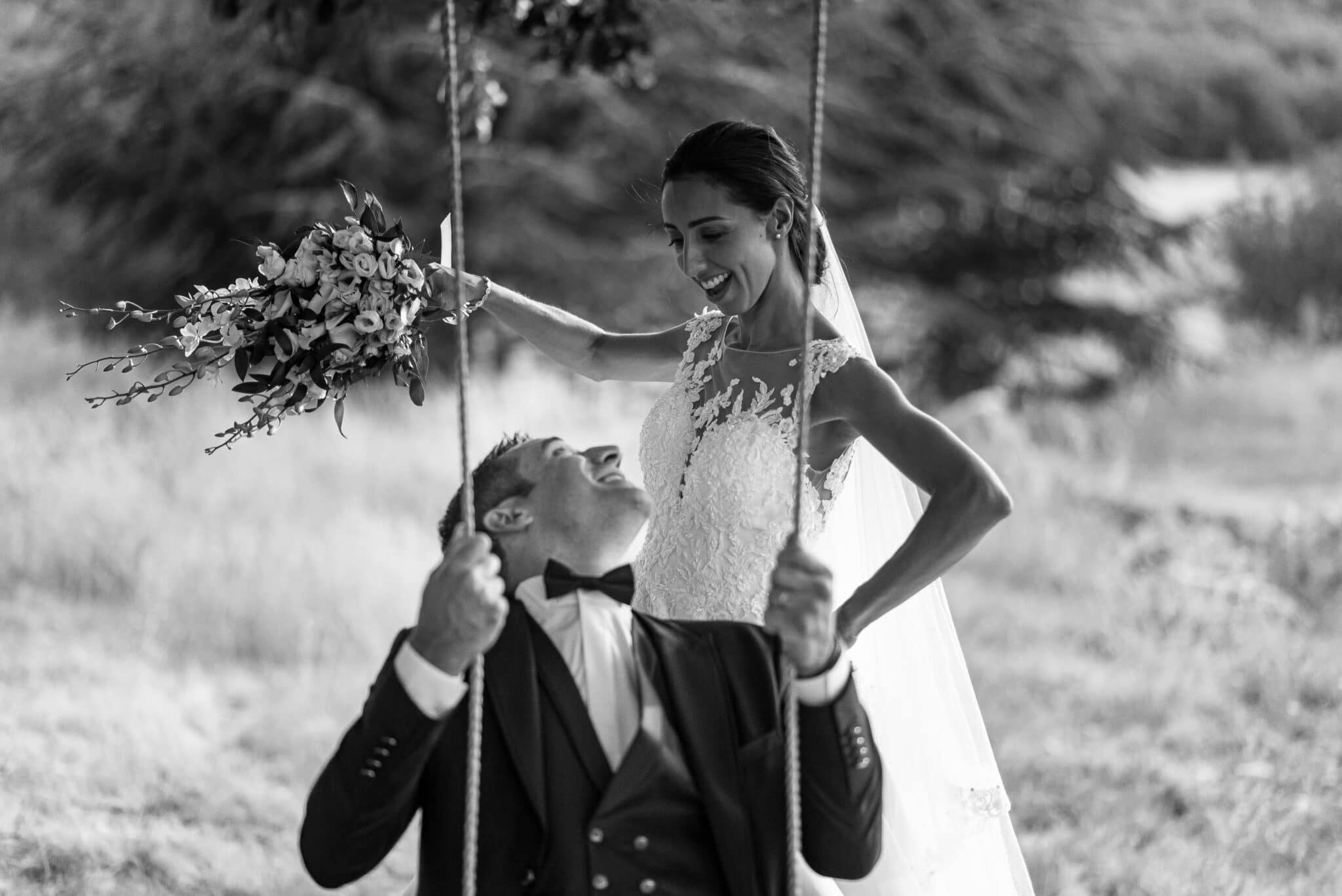 The newlyweds play on the swing